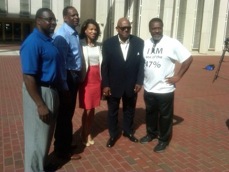 Group picture that includes Reverend Greg James (2nd from left), Kemba Smith (middle), and Actor Charles Dutton (2nd right) at the press conference launching the campaign