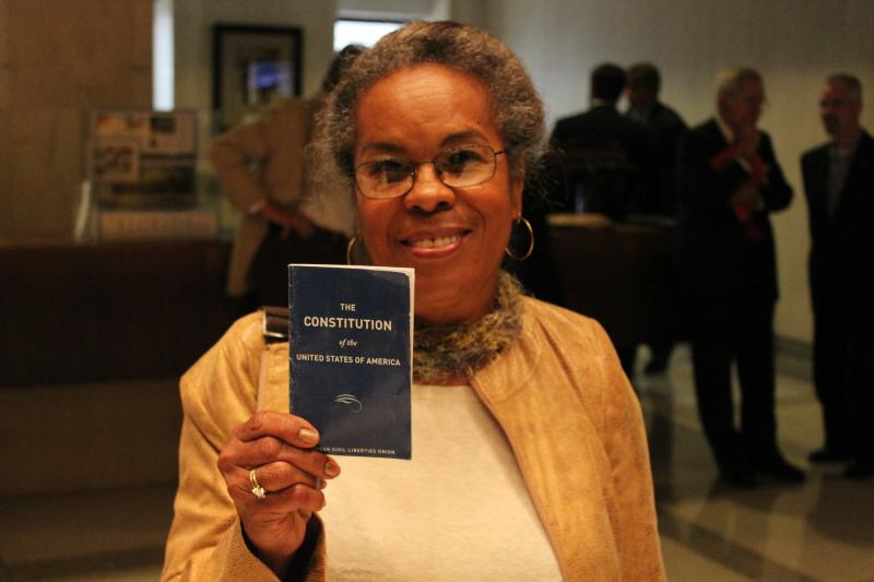 Cynthia Gardner-Williams holds up a copy of the U.S. Constitution