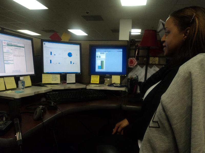 Passion Ellis, a hotline abuse call taker, at her desk, using the new abuse reporting tool.