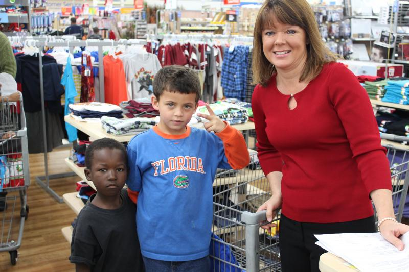 Leanne Laggmann helps her sponsored children shop.