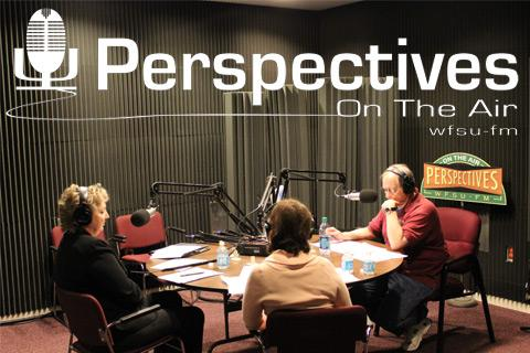 Tom Flanigan sitting in the studio with guests.