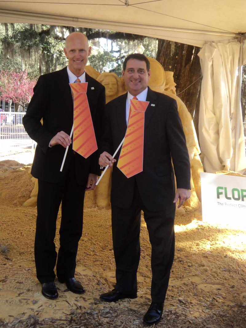 Governor Rick Scott and Enterprise Florida's President and CEO Gray Swoope with the orange neck ties, part of the new business brand campaign.