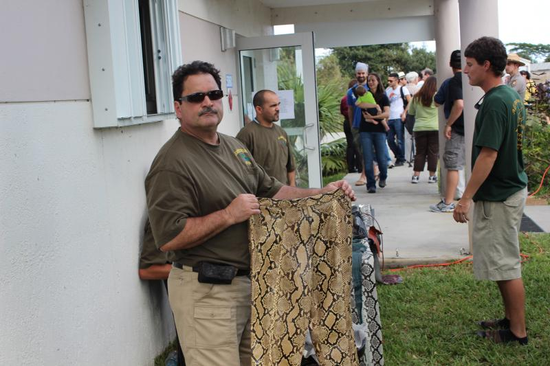 Brian Wood, owner of All American Gator Products is holding a pant made from pyhon skin