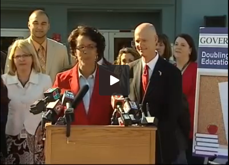 Gov.Rick Scott stands with teachers at Ocoee Middle School