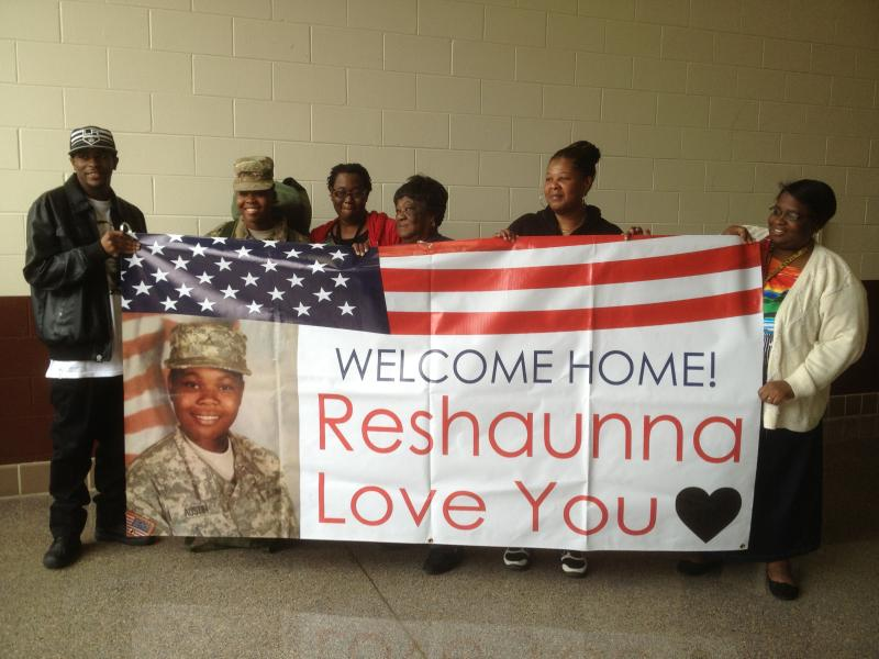 Family members of the Florida Army National Guard pose for pictures at the homecoming ceremony in Quincy, Florida