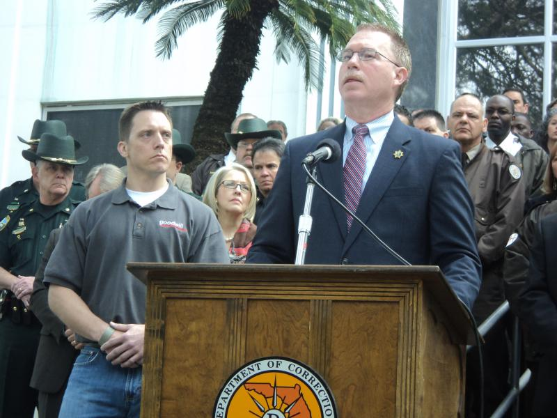 Florida Department of Corrections Secretary Mike Crews holding a press conference about the drop in the state's recidivism rate. Standing next to him (left) is former inmate, Eric Smallridge.