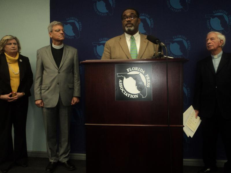 Sheila Hopkins of Florida Catholic Conference (left), Tallahassee Citizens Against the Death Penalty Chair Juvais Harrington (2nd from the right), and retired Reverend Emory Hingst (far right) ask for stay of execution for Paul Howell at press conference.