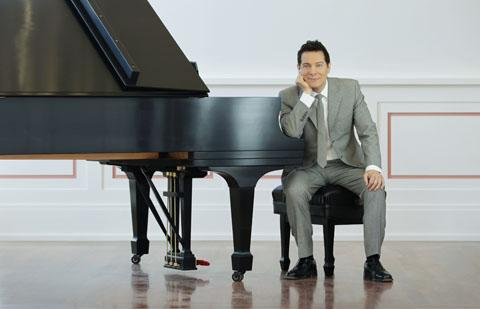 Michael Feinstein seated at piano