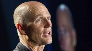 Governor Rick Scott says Florida will expand Medicaid under the federal healthcare law