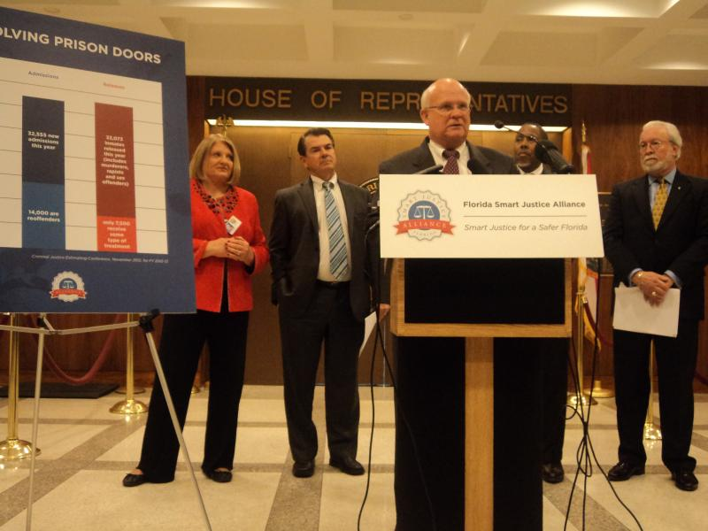"""Representative Dennis Baxley (R-Ocala) is joined by Senator Thad Altman (R-Melbourne), Representative Darryl Rouson (D-St. Petersburg), and Florida Smart Justice Alliance President and CEO Barney Bishop at the unveil of a """"Smart Justice"""" proposal Tuesday."""