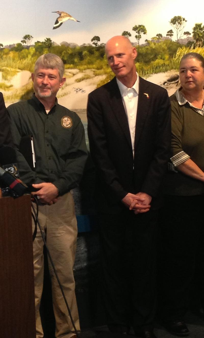 Fla. Gov. Rick Scott (center) at the Apalachicola National Estuarine Research Reserve Environmental Education and Training Center on Monday