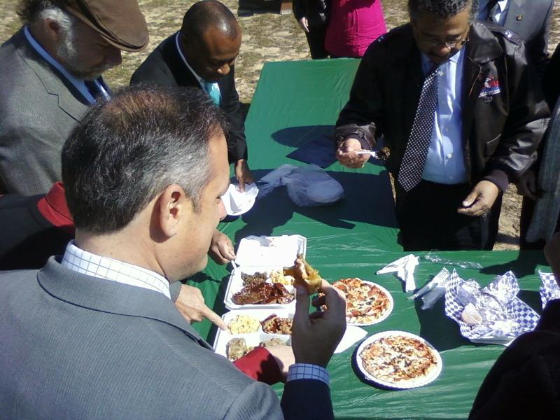 City Commissioner Scott Maddox, Gil Ziffer and Mayor John Marks take the ceremonial first bite.