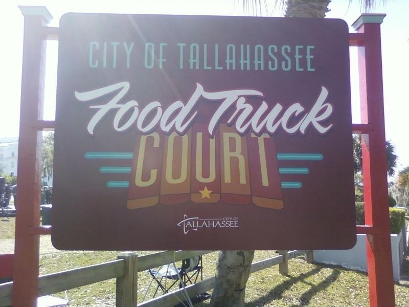 Government officials unveiled the new food truck court sign.