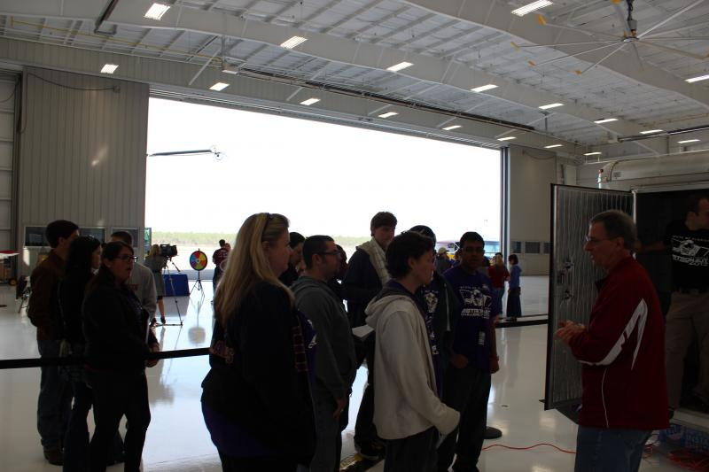 Students await to enter the shuttle.