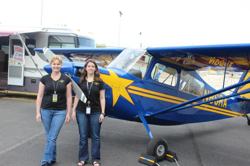 Faith Drewry and business partner Lacey Smith pose by one of their planes.