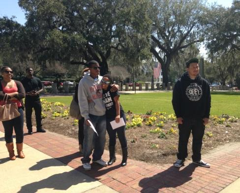 Melanie Andrade (center-right), outreach director for FAMU's Dream Defenders chapter, gets a hug after reading on the Capitol steps.