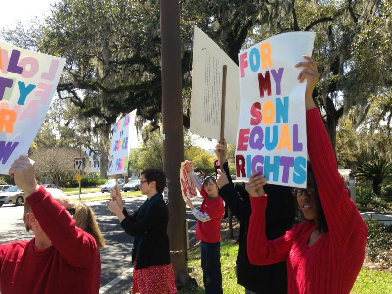 Gay marriage supporters rally at the Florida Capitol on Monday