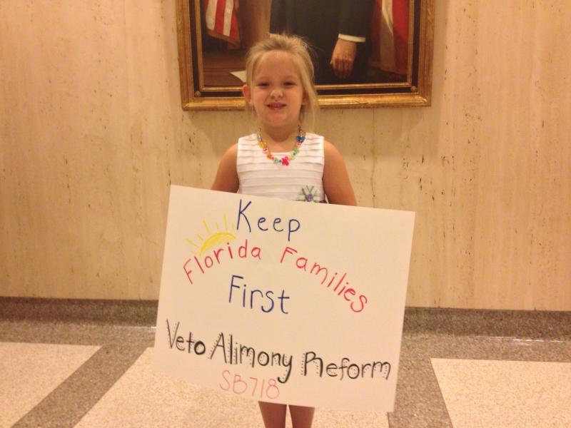 A young girl joins her mother to ask Governor Scott to veto alimony bill.