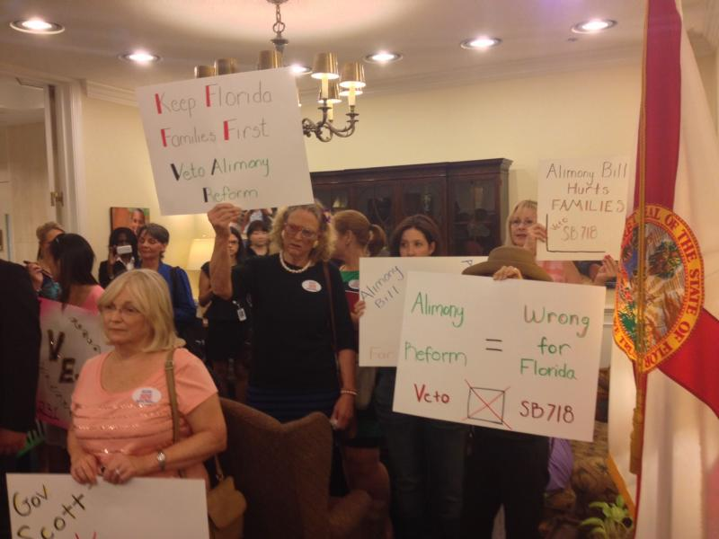 Protesters crowd the Governor's office Friday.