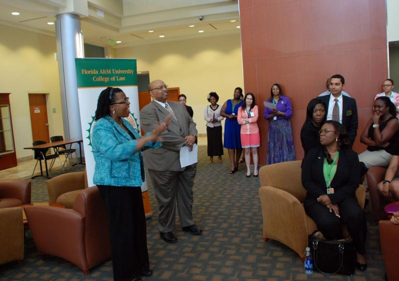 FAMU College of Law Dean LeRoy Pernell stands with Alicia Jackson, director of the FAMU College of Law Bar Exam Success Training (B.E.S.T.) Program, as they announce the February 2013 Bar Passage Rate to current law students, faculty and staff.