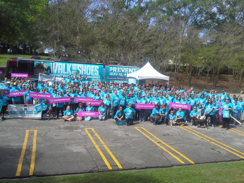 Photo of the group before they leave to go on the last leg of the 1,500 mile walk in the parking lot of Governor's Square Mall in Tallahasse.