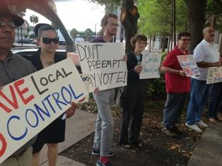 Central Florida activists protest a bill preempting local governments on sick leave policies