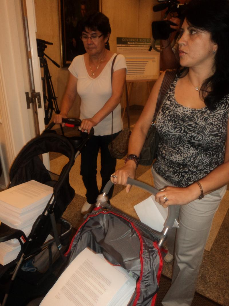 Two of the women carrying thousands of petitions urging the Governor's veto of HB 655 in baby strollers.