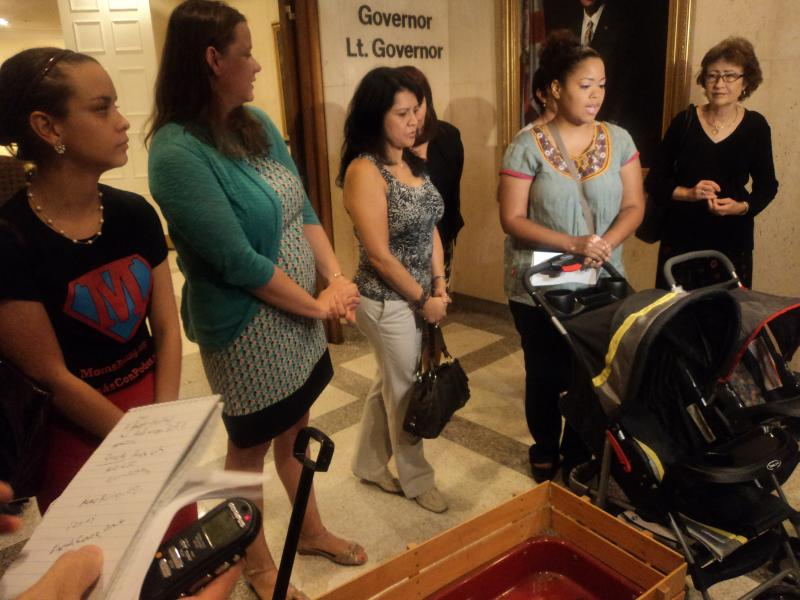 The women talking to reporters about their opposition to the Sick Leave Preemption bill, including Organize Now's Stephanie Porta (2nd left) and Denise Diaz (2nd from the right).