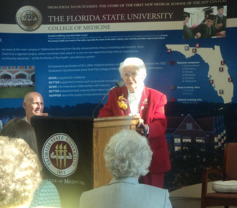 """Governor Rick Scott listens as Dr. Charlotte Maguire talks about her many accompishments that earned her the """"Great Floridian"""" award."""