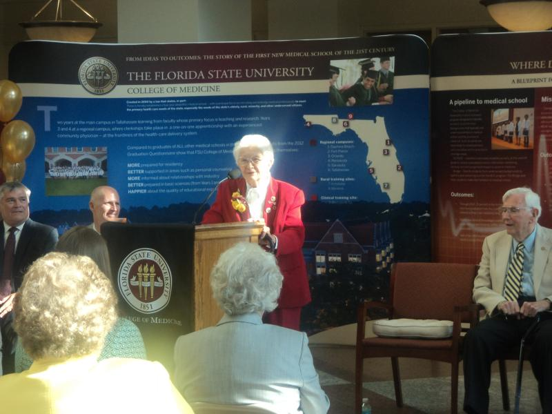 Governor Rick Scott, FSU President Eric Barron (far left), and former Florida Governor Reubin Askew (far right) listen to Dr. Charlotte Maguire during Thursday's ceremony.