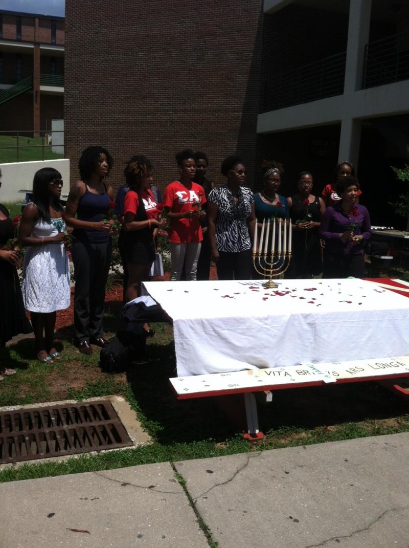 Members of the Sigma Alpha Iota Music Fraternity commemorate Founder's Day