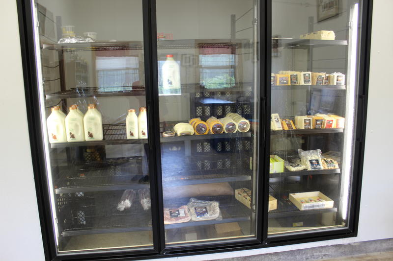 Dairy products are for sale in the Ocheesee store front on site.
