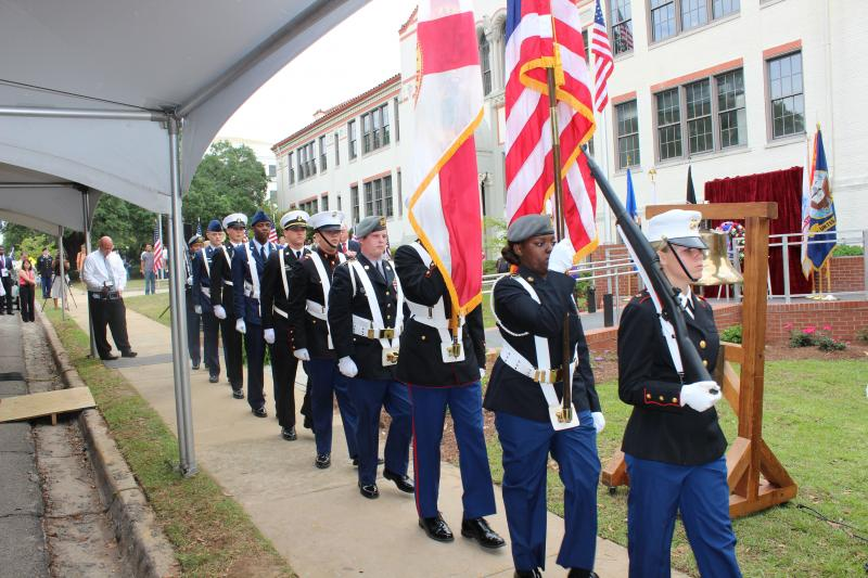 Combined Color Guard, Leon County Schools JROTC walks past the audience after presentation of colors.