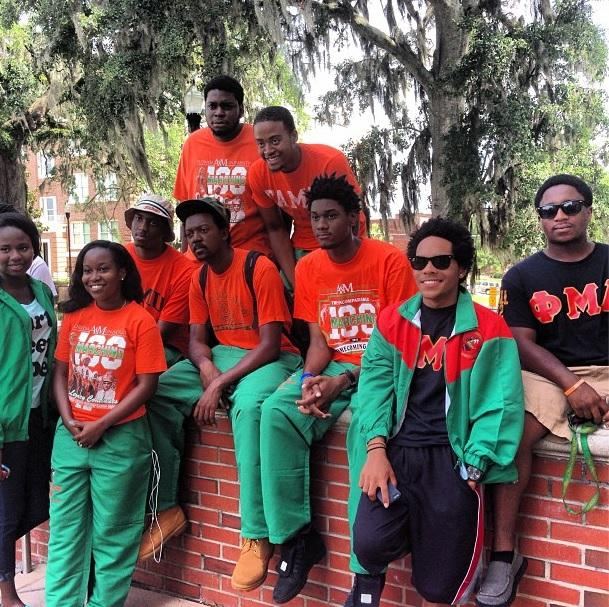 Marching 100 Band members following the Thursday announcement that the suspension on the band is lifted. Band member Brianni Lundy (2nd left) says she's happy about the news.