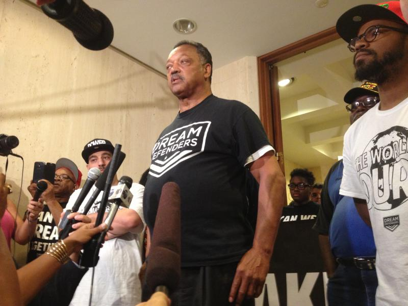 Reverend Jesse Jackson addresses reporters and protesters at governor's office.