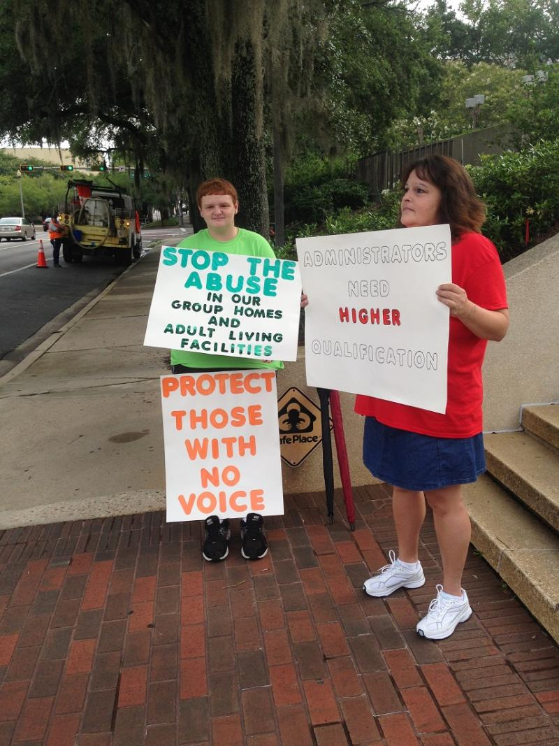 Roxanna Jeffries and her son Matthew protest at the Florida Capitol on July 1.