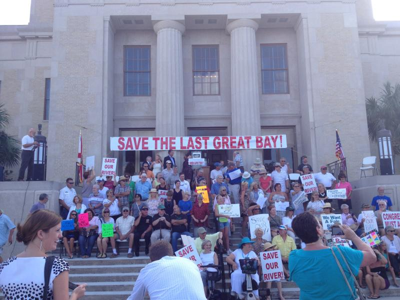 Community members rally on the steps of the Franklin County Courthouse before the Senate hearing commenced.
