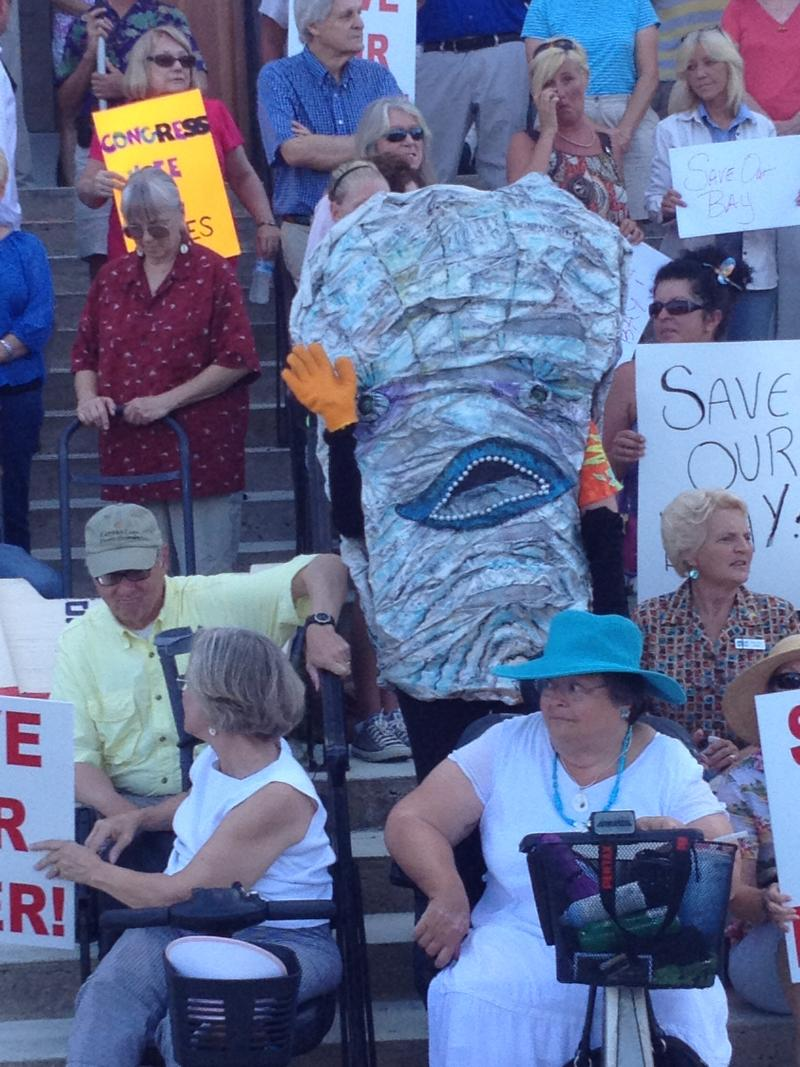 Apalachicola's mascot, the oyster, joins citizens on the steps of the Franklin County Courthouse.