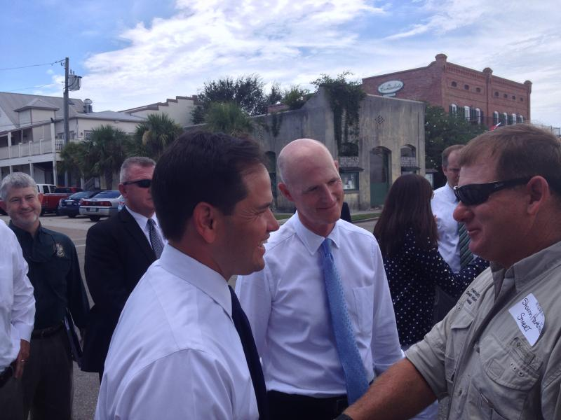 Marco Rubio and Governor Scott shake hands with Shannon Hartsfield of the Franklin County Seafood Workers Association