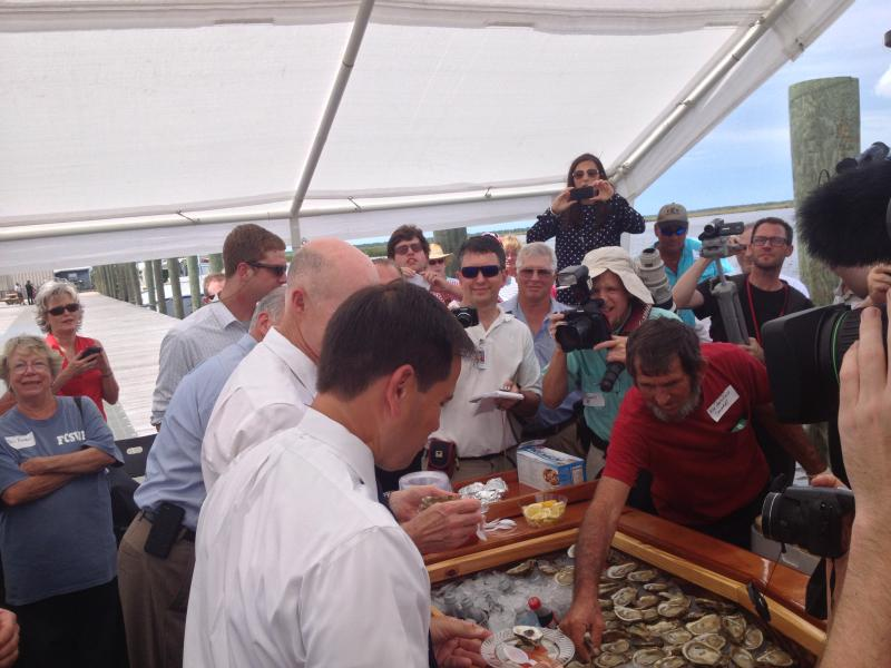 Senator Marco Rubio and Governor Rick Scott enjoy fresh oysters at Apalachicola.