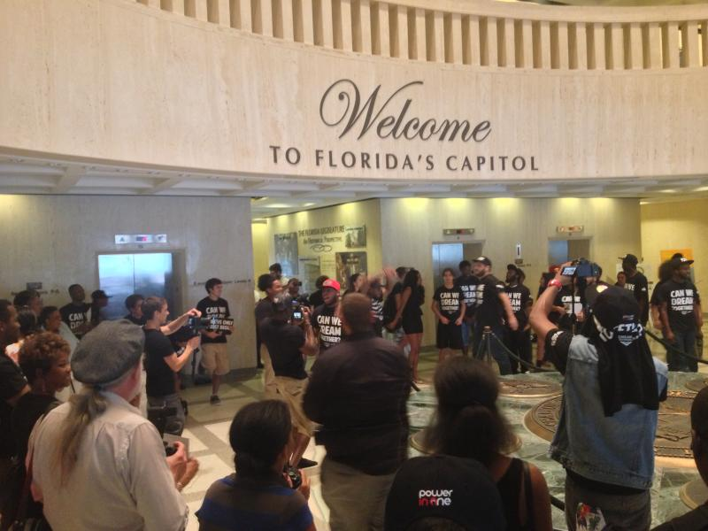 Dream Defenders gather in the building's rotunda for a final hurrah.