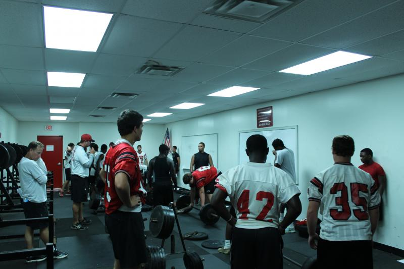 Leon High's Varsity footballers weight train before their 2013 season.