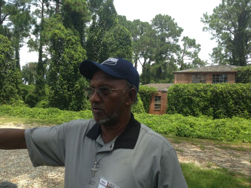 Former Dozier resident Johnny Gaddy says he saw human hands in the trash there.