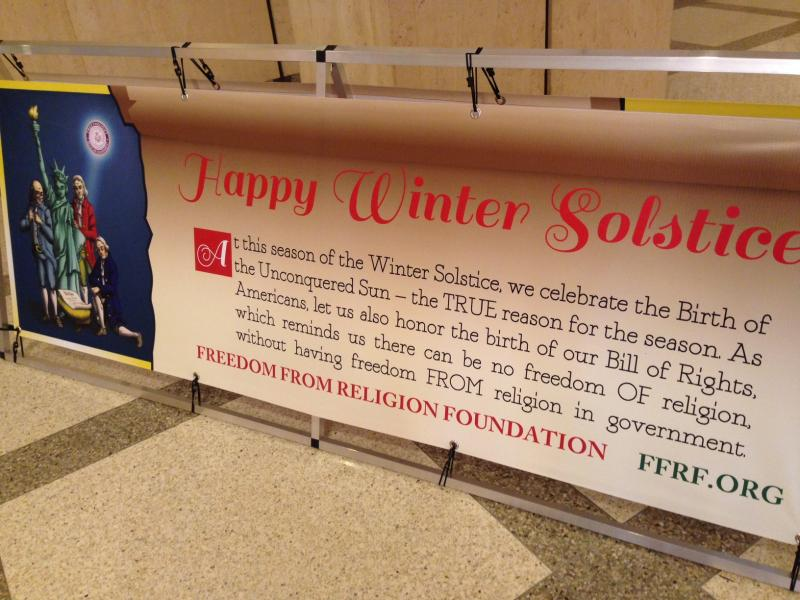 Banners similar to this have gone up at other state Capitols where Christmas nativity scenes are displayed