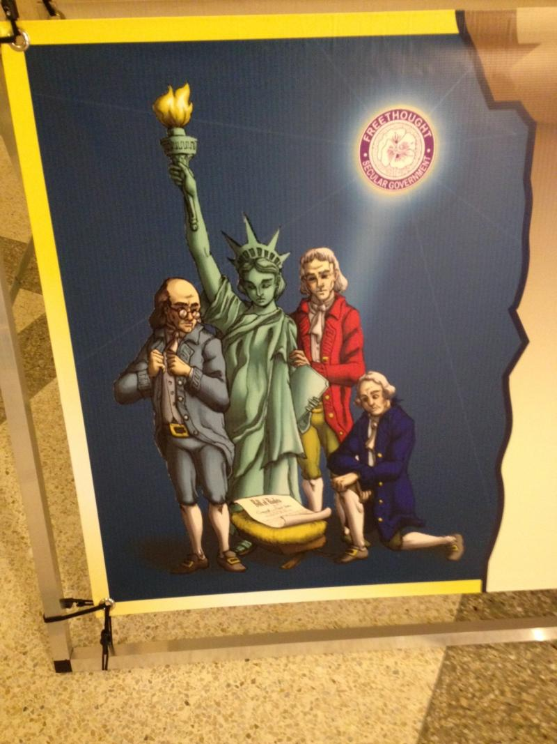 The Freedom from Religion Foundation's banner depicts the founding fathers celebrating the birth of the Constitution