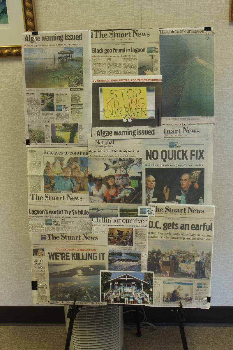 This collage sits outside the Everglades Foundation and shows a sampling of headlines from newspapers across the state about toxic algae booms