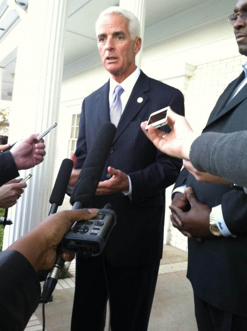 Charlie Crist with Tallahassee Attorney Darry Parks, talks to reporters during a fundraiser at Parks and Crump Law Firm