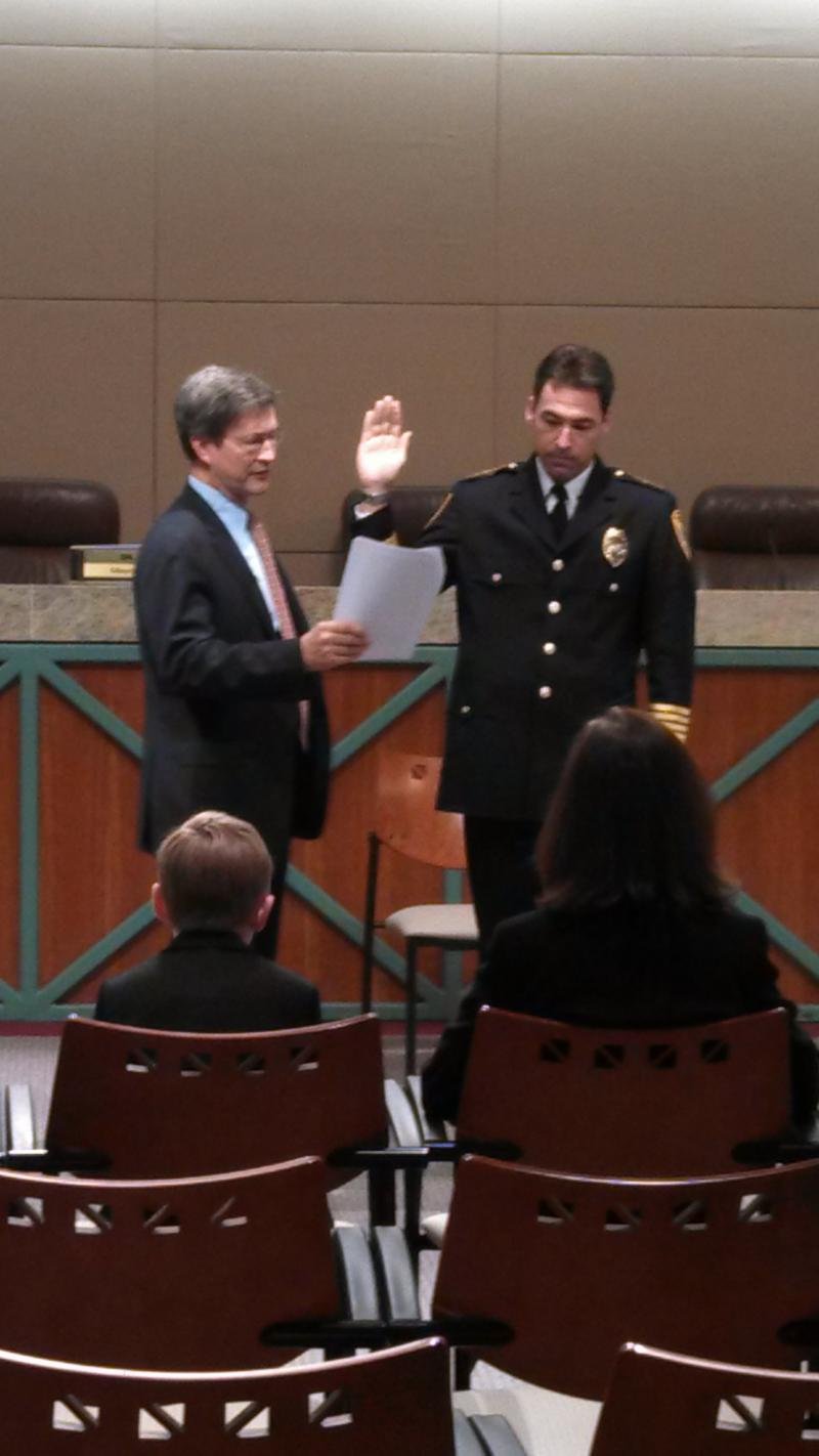New Police Chief Michael DeLeo gets sworn in December 30, 2013, as his family looks on.