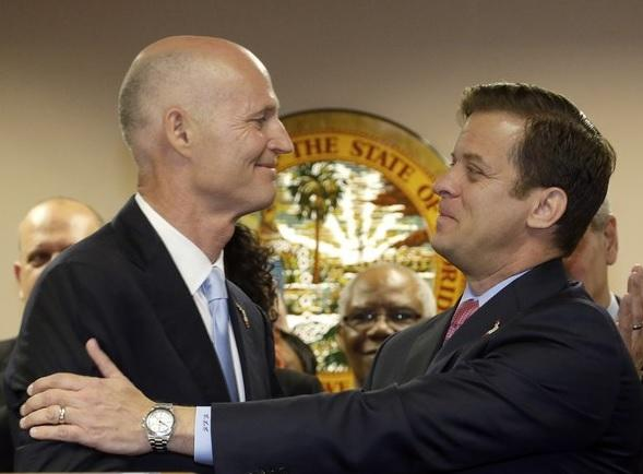 Governor Rick Scott (left) congratulates Miami-Dade Property Appraiser Carlos Lopez-Cantera after naming him lieutenant governor and his running mate for 2014, during a news conference, Tuesday, Jan. 14, 2014 in Miami.