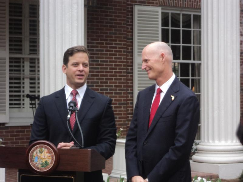 Following actual swearin-in ceremony, Florida's newest Lieutenant Governor Carlos Lopez-Cantera (left) joined by Governor Rick Scott to speak to reporters at the Governor's mansion Monday.